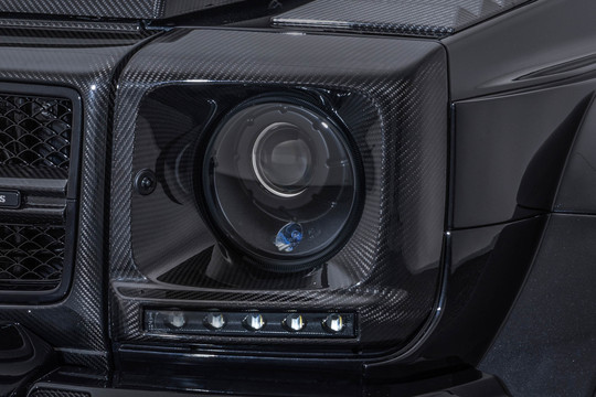 Carbon headlight surrounds glossy